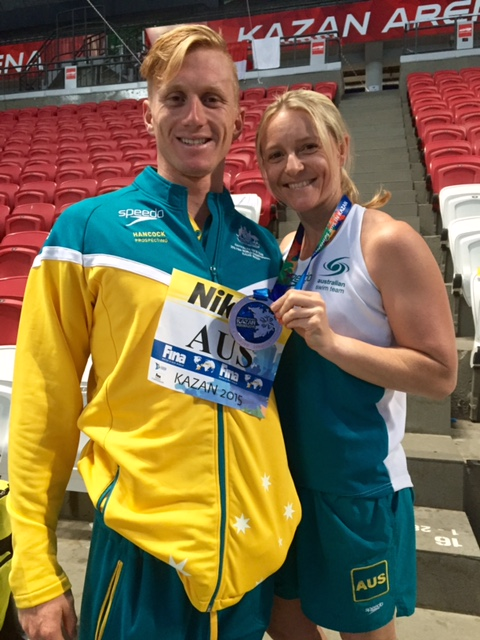 Thea congratulating 4x200m Free Swimmer Dan Smith on a job well done