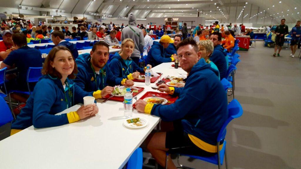 Team mates in Rio Village Dining Hall