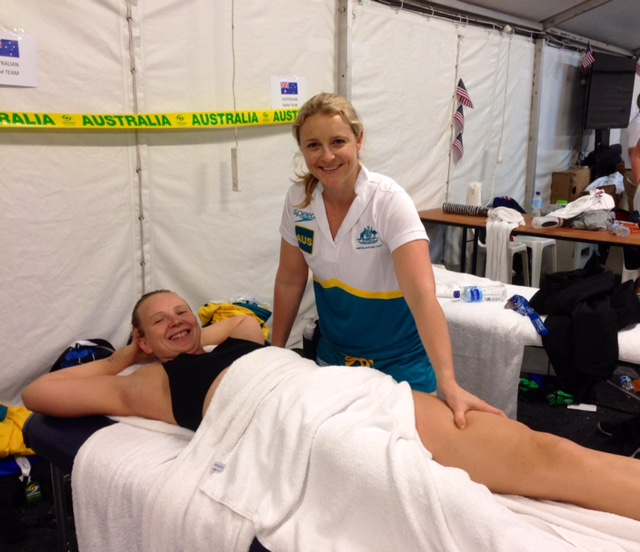 Thea massaging Melanie Wright at Pan Pacs 2014