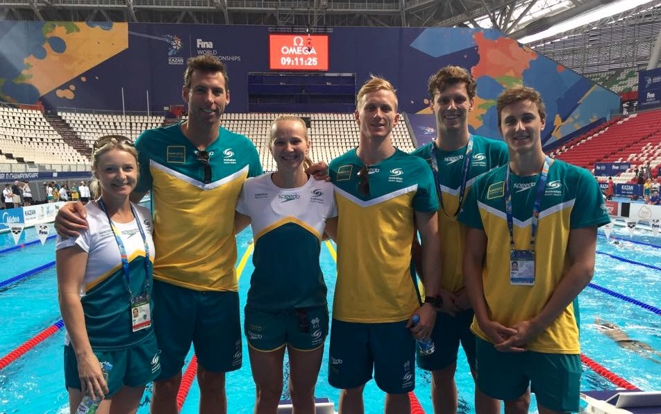 Thea with GC crew (with Cam McEvoy this time!) in Russia. So tiny compared to these athletes ..