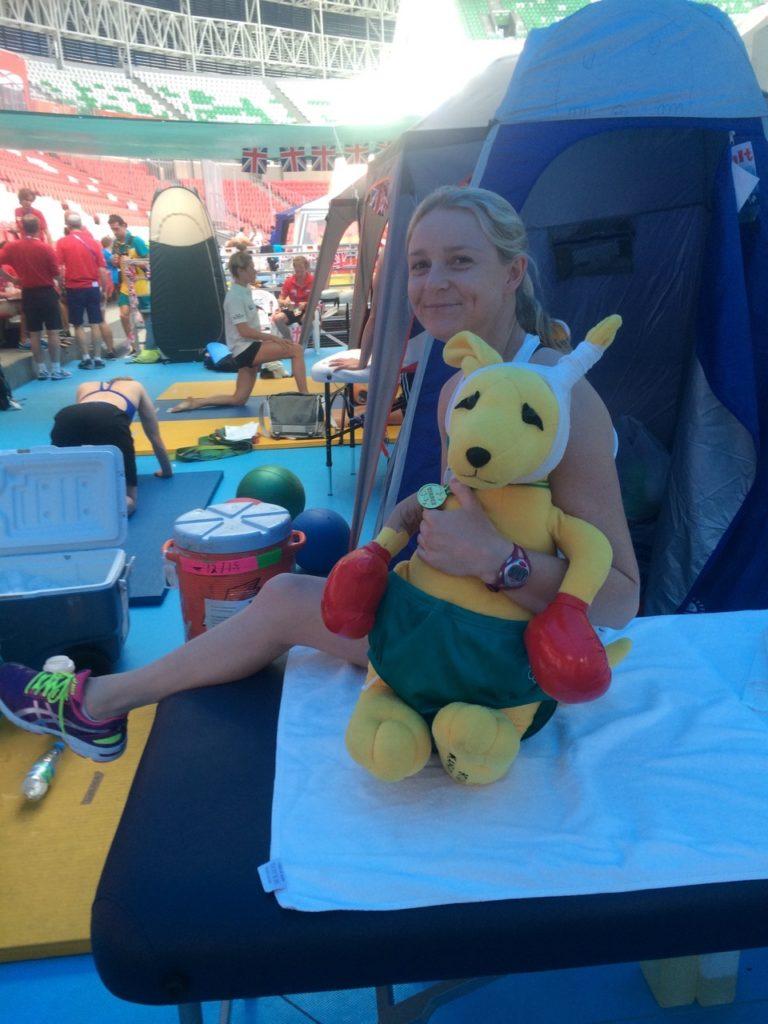 Thea comforting BK (Boxing Kangaroo) at 2015 Swim Worlds