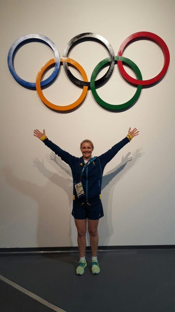 Thea under Olympic Rings in Rio