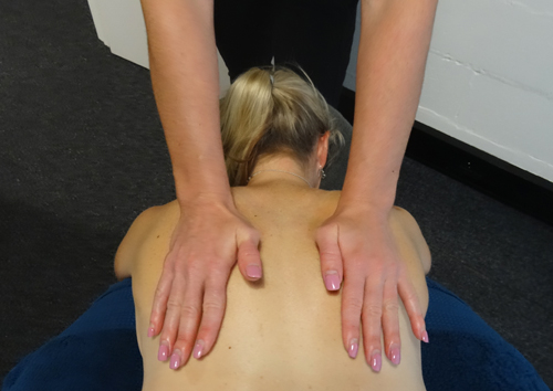 Massage therapist Hollie Morse giving hands on treatment at No More Niggles massage therapy clinic, Robina, Gold Coast